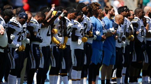 Members of the Los Angeles Chargers link arms during the national anthem before an NFL football game against the Kansas City Chiefs, Sunday, Sept. 24, 2017, in Carson, Calif. (AP Photo/Jae C. Hong)