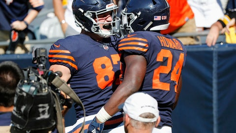 Chicago Bears running back Jordan Howard (24) celebrates his game-winning touchdown with tight end Adam Shaheen (87) in overtime of an NFL football game against the Pittsburgh Steelers, Sunday, Sept. 24, 2017, in Chicago. The Bears won 23-17. (AP Photo/Charles Rex Arbogast)