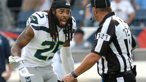 Seattle Seahawks cornerback Richard Sherman (25) argues a penalty call with umpire Paul King (121) in the first half of an NFL football game against the Tennessee Titans Sunday, Sept. 24, 2017, in Nashville, Tenn. (AP Photo/Mark Zaleski)