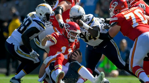 Kansas City Chiefs quarterback Alex Smith (11) is sacked by Los Angeles Chargers defensive end Joey Bosa, bottom and defensive end Corey Liuget (94) during the first half of an NFL football game, Sunday, Sept. 24, 2017, in Carson, Calif. (AP Photo/Mark J. Terrill)