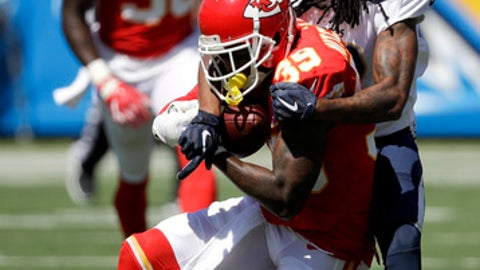 Kansas City Chiefs cornerback Terrance Mitchell intercepts a pass intended for Los Angeles Chargers wide receiver Travis Benjamin during the first quarter of an NFL football game, Sunday, Sept. 24, 2017, in Carson, Calif. (AP Photo/Jae C. Hong)