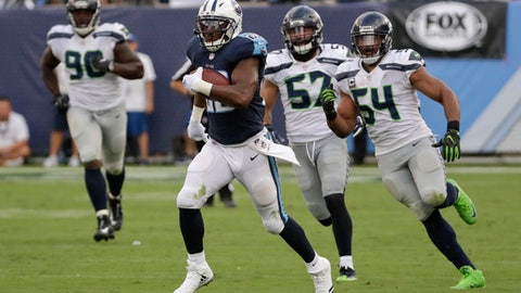 Tennessee Titans running back DeMarco Murray leaves Seattle Seahawks defenders behind as he scores a touchdown on a 75-yard run in the second half of an NFL football game Sunday, Sept. 24, 2017, in Nashville, Tenn. (AP Photo/James Kenney)