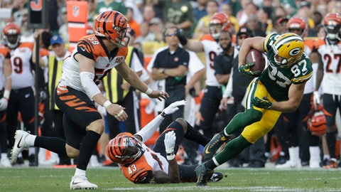 Green Bay Packers' Jordy Nelson gets away from Cincinnati Bengals' Nick Vigil and George Iloka after a catch during the second half of an NFL football game Sunday, Sept. 24, 2017, in Green Bay, Wis. (AP Photo/Morry Gash)