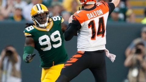 Cincinnati Bengals' Andy Dalton throws past Green Bay Packers' Ricky Jean Francois during the second half of an NFL football game Sunday, Sept. 24, 2017, in Green Bay, Wis. (AP Photo/Matt Ludtke)