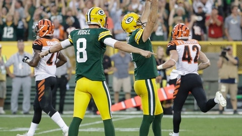 Green Bay Packers' Mason Crosby celebrates the game-winning field goal during overtime of an NFL football game against the Cincinnati Bengals Sunday, Sept. 24, 2017, in Green Bay, Wis. (AP Photo/Morry Gash)