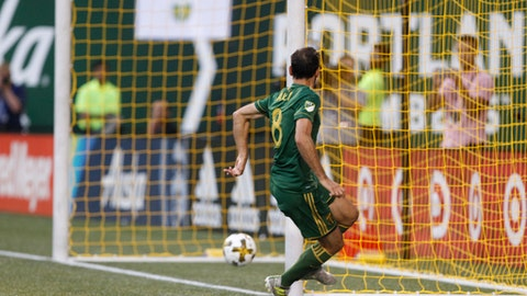 Portland Timbers' Diego Valeri taps in a goal during an MLS soccer match against the Orlando City SC in Portland, Ore., Sunday, Sept. 24, 2017. (Sean Meagher/The Oregonian via AP)