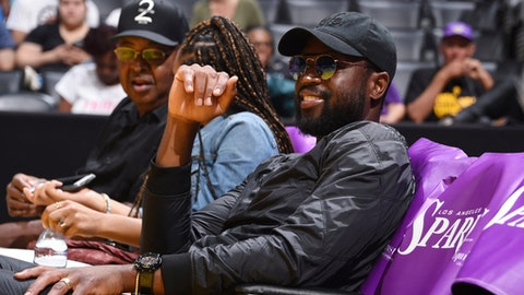 LOS ANGELES, CA - SEPTEMBER 1:  Dwyane Wade of the Chicago Bulls attends the game between the Atlanta Dream and the Los Angeles Sparks on September 1, 2017 at the STAPLES Center in Los Angeles, California. NOTE TO USER: User expressly acknowledges and agrees that, by downloading and or using this photograph, user is consenting to the terms and conditions of the Getty Images License Agreement. Mandatory Copyright Notice: Copyright 2017 NBAE (Photos by Adam Pantozzi/NBAE via Getty Images)