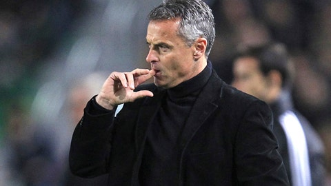FILE - In this Feb. 22, 2015 file photo, soccer coach Fran Escriba touches his face during a Spanish La Liga soccer match in Elche, Spain. Villarreal has fired coach Fran Escriba on Monday Sept. 25, 2017 after the team's disappointing start in the Spanish league. Villarreal says a new coach would be announced shortly. (AP Photo/Alberto Saiz, File)