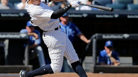 New York Yankees' Aaron Judge looks after a two-run homer during the third inning of a baseball game against the Kansas City Royals at Yankee Stadium, Monday, Sept. 25, 2017, in New York. It was Judge's 49th home run, which ties the MLB rookie home run record. (AP Photo/Seth Wenig)