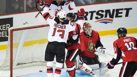 New Jersey Devils' Nico Hischier, of Switzerland, reacts after scoring on Ottawa Senators Mike Condon during the first period of an NHL preseason hockey game in Summerside, Prince Edward Island, Monday, Sept. 25, 2017. (Andrew Vaughan/The Canadian Press via AP)