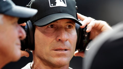 FILE - This April 9, 2017 file photo shows MLB umpire Angel Hernandez in the first inning of a baseball game between the Arizona Diamondbacks and the Cleveland Indians in Phoenix. Hernandez is asking that his lawsuit alleging race discrimination by Major League Baseball not be dismissed and that it remain in federal court in Ohio. (AP Photo/Rick Scuteri, file)