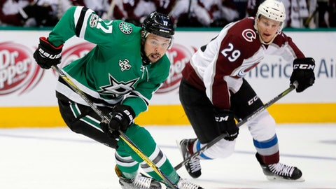 Dallas Stars center Devin Shore (17) advances the puck up ice as Colorado Avalanche center Nathan MacKinnon (29) defends in the first period of a preseason NHL hockey game, Monday, Sept. 25, 2017, in Dallas. (AP Photo/Tony Gutierrez)