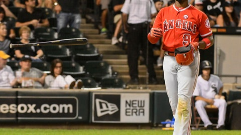 Los Angeles Angels's Justin Upton flips his bat after striking out against the Chicago White Sox during the eighth inning of a baseball game in Chicago on Monday, Sept. 25, 2017. (AP Photo/Matt Marton)