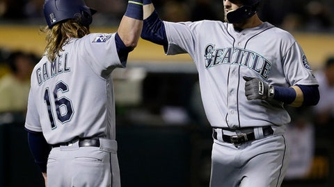 Seattle Mariners' Mitch Haniger right, celebrates with Ben Gamel (16) after hitting a two-run home run off Oakland Athletics' Daniel Gossett during the fifth inning of a baseball game Monday, Sept. 25, 2017, in Oakland, Calif. (AP Photo/Ben Margot)