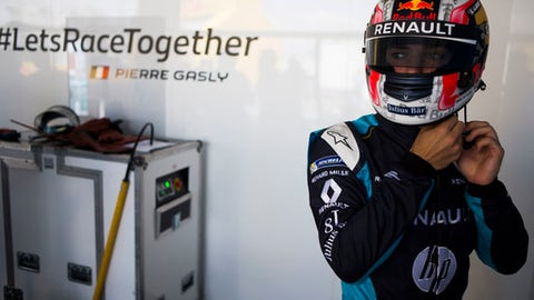 """FILE - This is a Saturday, July 15, 2017 file photo of Renault e.dams driver Pierre Gasly gears up ahead of a qualifying run ahead of the Formula E all-electric auto race,  in the Brooklyn borough of New York. Pierre Gasly will make his Formula One debut with Toro Rosso at the Malaysian Grand Prix, on Oct. 1, 2017, after Daniil Kvyat was dropped. Team principal Franz Tost says Kvyat's poor performances led to them """"standing him down for the next races."""" The Russian driver has four points from 14 races. Gasly, a Frenchman, has been racing in Japan in the Super Formula. (AP Photo/Michael Noble Jr., File)"""