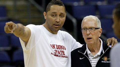 San Diego State assistant coach Tony Bland, left, talks with head coach Steve Fisher during practice Thursday, March 15, 2012, in Columbus, Ohio. San Diego State plays North Carolina State in the second round of the NCAA men's college basketball tournament game on Friday. (AP Photo/Tony Dejak)