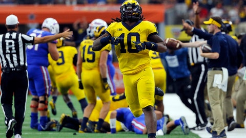 FILE - In this  Saturday, Sept. 2, 2017, file photo, Michigan linebacker Devin Bush (10) celebrates a Florida turnover during an NCAA college football game, in Arlington, Texas. The sophomore is quickly becoming the leader of Michigan's top-rated defense. (AP Photo/Tony Gutierrez, File)