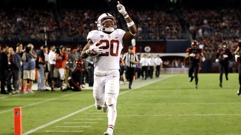 FILE - In this Sept. 16, 2017, file photo, Stanford running back Bryce Love scores a touchdown during the second half of an NCAA college football game against San Diego State in San Diego. He leads the nation in rushing at 196.75 yards per game and is averaging 10.78 yards per carry. In each game this season, Love has broken off a run of 50 yards or more. (AP Photo/Gregory Bull, File)