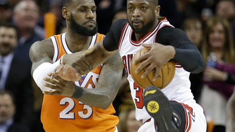 Cleveland Cavaliers' LeBron James, left, fouls Chicago Bulls' Dwyane Wade in the second half of an NBA basketball game, Wednesday, Jan. 4, 2017, in Cleveland. The Bulls won 106-94. (AP Photo/Tony Dejak)