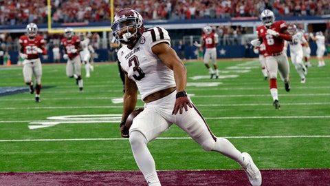 FILE - In this Saturday, Sept. 23, 2017, file photo, Texas A&M wide receiver Christian Kirk (3) celebrates in the end zone after returning a kick off 100 yards for a touchdown in the second half of an NCAA college football game against Arkansas in Arlington, Texas. Through Texas A&M's first three games many wondered if Kirk was frustrated as near-constant double teams kept him from posting the big numbers he had the past two seasons. That all changed on Saturday when he returned a kick 100 yards for a touchdown and had 110 yards receiving with two touchdowns in a win over Arkansas. (AP Photo/Tony Gutierrez, File)