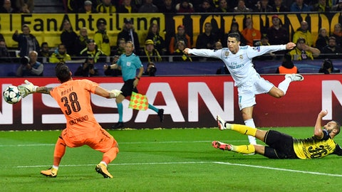 Real Madrid's Cristiano Ronaldo, center, scores his side's 3rd goal during the Champions League group H soccer match between Borussia Dortmund and Real Madrid CF in Dortmund, Germany, Tuesday, Sept. 26, 2017. (AP Photo/Martin Meissner)