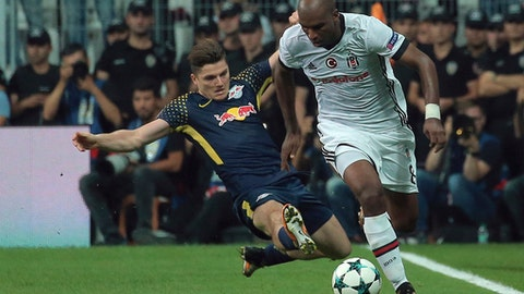 Besiktas' Ryan Babel, right, with RB Leipzig's Marcel Sabitzer during the Champions League group G soccer match between Besiktas and RB Leipzig at the Vodafone Park Stadium in Istanbul, Tuesday, Sept. 26, 2017. (AP Photo)