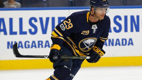 FILE - In this Saturday Sept. 23, 2017, file photo, Buffalo Sabres forward Jason Pominville (28) skates prior to the first period of a preseason NHL hockey game against the Toronto Maple Leafs in Buffalo, N.Y. Pominville is back in Buffalo eager to help the Sabres recapture the buzz they once generated in town a decade ago. (AP Photo/Jeffrey T. Barnes, File)