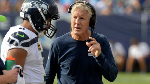 "FILE - In this Sept. 24, 2017, file photo, Seattle Seahawks head coach Pete Carroll talks with quarterback Russell Wilson in the first half of an NFL football game against the Tennessee Titans in Nashville, Tenn. Almost all of the 200 players who took part in protests during Sunday's NFL games were doing so for the first time, but not just because President Donald Trump suggested team owners should ""fire 'em."" Seattle coach Carroll and linebackers Von Miller and Lorenzo Alexander discussed, in their own words, how they became ""woke."" (AP Photo/Mark Zaleski, File)"