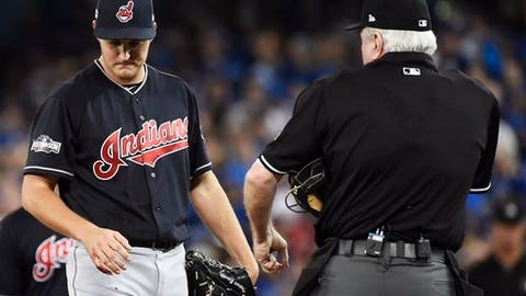 FILE - In this Oct. 17, 2016, file photo, Cleveland Indians starting pitcher Trevor Bauer looks at his bleeding finger during the first inning of game three American League Championship Series baseball action against the Toronto Blue Jays in Toronto. The Indians hope it stays that way. Cleveland's nerdy pitcher, who is also an avid enthusiast of flying the unmanned, remote-controlled devices, lost the drone on Monday, Sept. 25, 2017, in a suburban park where he was zipping it around trees and other obstacles with a camera attached. (Nathan Denette/The Canadian Press via AP, File)