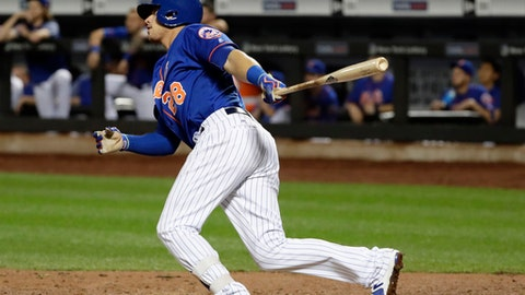 New York Mets' Travis Taijeron watches his single that drove in the winning run during the ninth inning of a baseball game against the Atlanta Braves on Tuesday, Sept. 26, 2017, in New York. The Mets won 4-3. (AP Photo/Frank Franklin II)