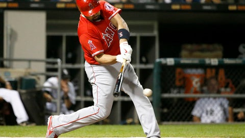 Los Angeles Angels' Albert Pujols hits a two-run single off Chicago White Sox relief pitcher Mike Pelfrey during the seventh inning of a baseball game Tuesday, Sept. 26, 2017, in Chicago. (AP Photo/Charles Rex Arbogast)
