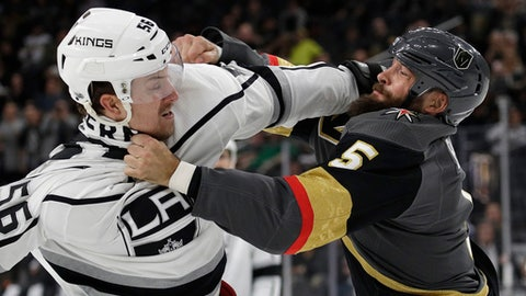 Los Angeles Kings defenseman Kurtis MacDermid, left, fights with Vegas Golden Knights defenseman Deryk Engelland during the first period of an NHL preseason hockey game Tuesday, Sept. 26, 2017, in Las Vegas. (AP Photo/John Locher)
