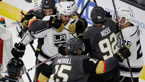 Vegas Golden Knights' Colin Miller (6) pulls Los Angeles Kings' Michael Mersch (49) away from the net during the third period of an NHL preseason hockey game Tuesday, Sept. 26, 2017, in Las Vegas. (AP Photo/John Locher)