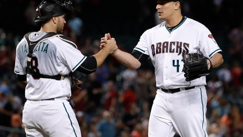 Arizona Diamondbacks relief pitcher David Hernandez and catcher Chris Iannetta celebrate after a baseball game against the San Francisco Giants, Tuesday, Sept. 26, 2017, in Phoenix. The Diamondbacks won 11-4. (AP Photo/Matt York)