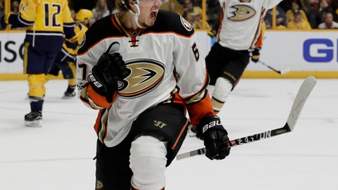 File-This May 18, 2017 file photo shows Anaheim Ducks center Rickard Rakell (67), of Sweden, celebrating his goal in the first period of Game 4 of the Western Conference final against the Nashville Predators in the NHL hockey Stanley Cup playoffs in Nashville, Tenn.  The Swede scored a career-high 33 goals last season but the hope is that featuring him as more of a playmaker can offset the loss of Ryan Kesler's offensive production. (AP Photo/Mark Humphrey, File)