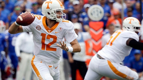 FILE - In this Sept. 16, 2017, file photo, Tennessee quarterback Quinten Dormady (12) looks for a receiver during the first half of an NCAA college football game against Florida in Gainesville, Fla.  Dormady has started Tennessee's first four games but was pulled in favor of Jarrett Guarantano in the second half of a 17-13 victory over Massachusetts last week. (AP Photo/John Raoux, File)