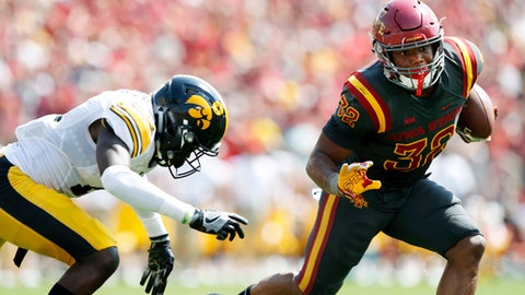 FILE - In this Sept. 9, 2017, file photo, Iowa State running back David Montgomery (32) runs from Iowa defensive back Michael Ojemudia, left, during the second half of an NCAA college football game in Ames, Iowa. Montgomery is averaging 5.7 yards per carry. (AP Photo/Charlie Neibergall, File)