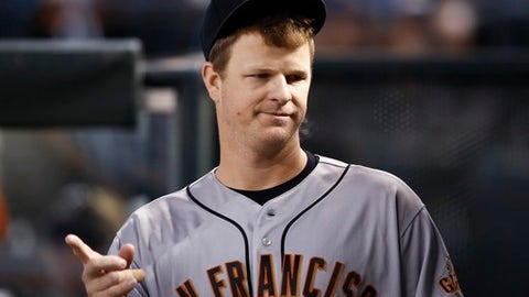 San Francisco Giants pitcher Matt Cain walks through the dugout during the third inning of a baseball game against the Arizona Diamondbacks Wednesday, Sept. 27, 2017, in Phoenix.  San Francisco pitcher Matt Cain says he'll retire after his start at home on Saturday against San Diego. The 32-year-old Cain informed teammates of his decision in a closed meeting before Wednesday's game at Chase Field against the Arizona Diamondbacks.  (AP Photo/Ross D. Franklin)