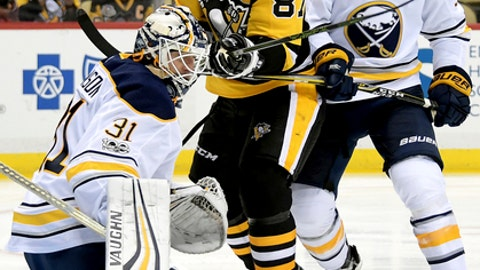 Buffalo Sabres goalie Chad Johnson makes a save on Pittsburgh Penguins' Sidney Crosby during the first period of an NHL hockey preseason game Wednesday, Sept. 27, 2017, in Pittsburgh. (Peter Diana/Pittsburgh Post-Gazette via AP)