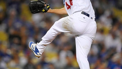 Los Angeles Dodgers starting pitcher Rich Hill watches a delivery during the seventh inning of a baseball game against the San Diego Padres, Wednesday, Sept. 27, 2017, in Los Angeles. (AP Photo/Mark J. Terrill)