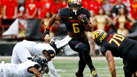 FILE - In this Sept. 9, 2017, file photo, Maryland running back Ty Johnson (6) rushes for a touchdown in the first half of an NCAA college football game against Towson in College Park, Md. One of the big early-season surprises so far has been Maryland's ability to run. Through three weeks, the Terrapins are No. 3 in the Big Ten at 224 yards per game. With their top two quarterbacks out for the season, it's a pretty good bet they'll run even more this week. The problem in this week's game: Minnesota has the league's best rushing defense. (AP Photo/Patrick Semansky, File)