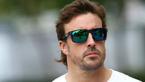 McLaren driver Fernando Alonso of Spain arrives at Sepang International Circuit ahead of the Malaysian Formula One Grand Prix in Sepang, Malaysia, Thursday, Sept. 28, 2017. (AP Photo/Vincent Phoon)