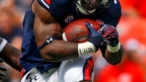 FILE - In this Sept. 16, 2017, file photo, Auburn running back Kamryn Pettway (36) finds a hole as he carries the ball during the first half of an NCAA college football game against Mercer in Auburn, Ala. Auburn tailbacks Kerryon Johnson and Kamryn Pettway just can't seem to get together.They're two of the 13th-ranked Tigers' top offensive playmakers, but have scarcely been healthy and available at the same time the past two seasons. (AP Photo/Butch Dill, File)