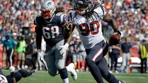 FILE - In this Sunday, Sept. 24, 2017, file photo, Houston Texans linebacker Jadeveon Clowney (90) returns a recovered fumble for a touchdown as New England Patriots tackle LaAdrian Waddle (68) chases during the first half of an NFL football game in Foxborough, Mass. Clowney's Houston teammates mocked him mercilessly when Bengals quarterback Andy Dalton tackled the defensive end to prevent him from scoring after recovering a fumble two weeks ago. Clowney made up for getting stopped last week when he scooped up another fumble and rumbled 22-yards for a touchdown to not only silence the criticism but impress his teammates in the process. (AP Photo/Steven Senne, File)
