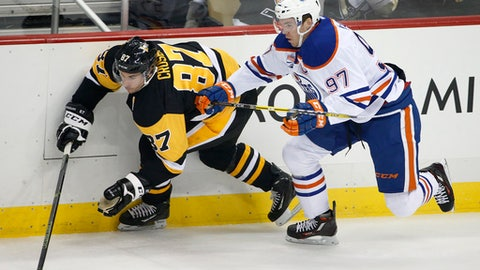 FILE - In this Nov. 8, 2016, file photo, Edmonton Oilers' Connor McDavid (97) and Pittsburgh Penguins' Sidney Crosby (87) battle for the puck during the first period of an NHL hockey game in Pittsburgh. Coming off back-to-back Conn Smythe Trophies as playoff MVP with the Stanley Cup champion Penguins, Crosby is widely considered by his peers as the best player in hockey. Crosby has just one true rival in that department: 20-year-old reigning MVP Connor McDavid, whose speed makes him a threat to be the NHL's best for the next decade or more.  (AP Photo/Gene J. Puskar, File)