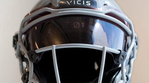 In this Sept. 11, 2017 photo a  VICIS Zero1 helmet is displayed in New York. The helmet that performed best in NFL testing this year is being used by 50 players spread across only half of the NFL teams.  (AP Photo/Mark Lennihan)