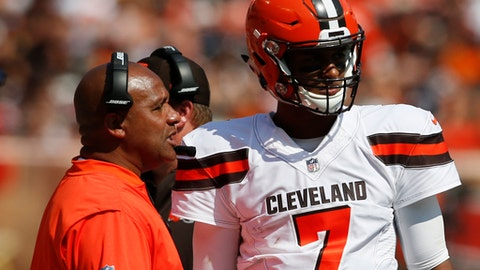 FILE - In this Sept. 10, 2017, file photo, Cleveland Browns head coach Hue Jackson talks with quarterback DeShone Kizer (7) during the first half of an NFL football game against the Pittsburgh Steelers in Cleveland. Lumped together at the bottom of the AFC North's standings, the Bengals (0-3) and Browns (0-3) both enter Sunday's matchup winless and desperate to salvage seasons that are quickly slipping away.(AP Photo/Ron Schwane)