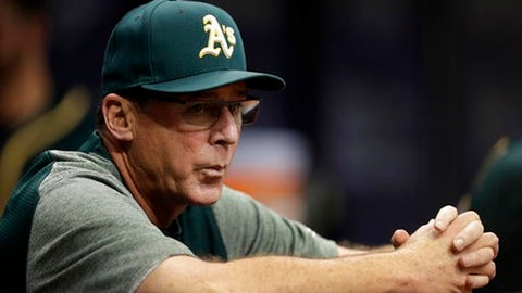 FILE - In this June 9, 2017, file photo, Oakland Athletics manager Bob Melvin watches the first inning of a baseball game against the Tampa Bay Rays in St. Petersburg, Fla. Melvin is set to manage at least two more years for the Athletics, with his latest extension announced Thursday, Sept. 28, 2017, set to take him through the 2019 season. (AP Photo/Chris O'Meara, File)