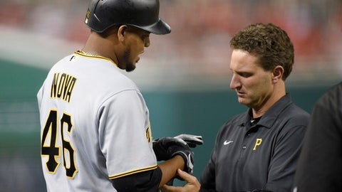 Pittsburgh Pirates' Ivan Nova (46) is tended to by a trainer after he was injured during the third inning of a baseball game against the Washington Nationals, Thursday, Sept. 28, 2017, in Washington. (AP Photo/Nick Wass)