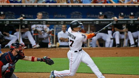Miami Marlins&#039 Giancarlo Stanton hits a home run during the fourth inning of a baseball game against the Atlanta Braves Thursday Sept. 28 2017 in Miami